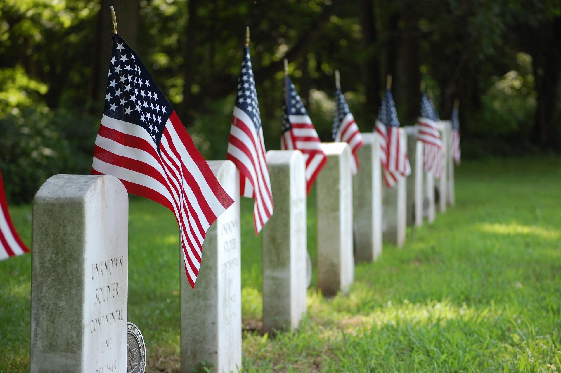 American flags beside gravestones