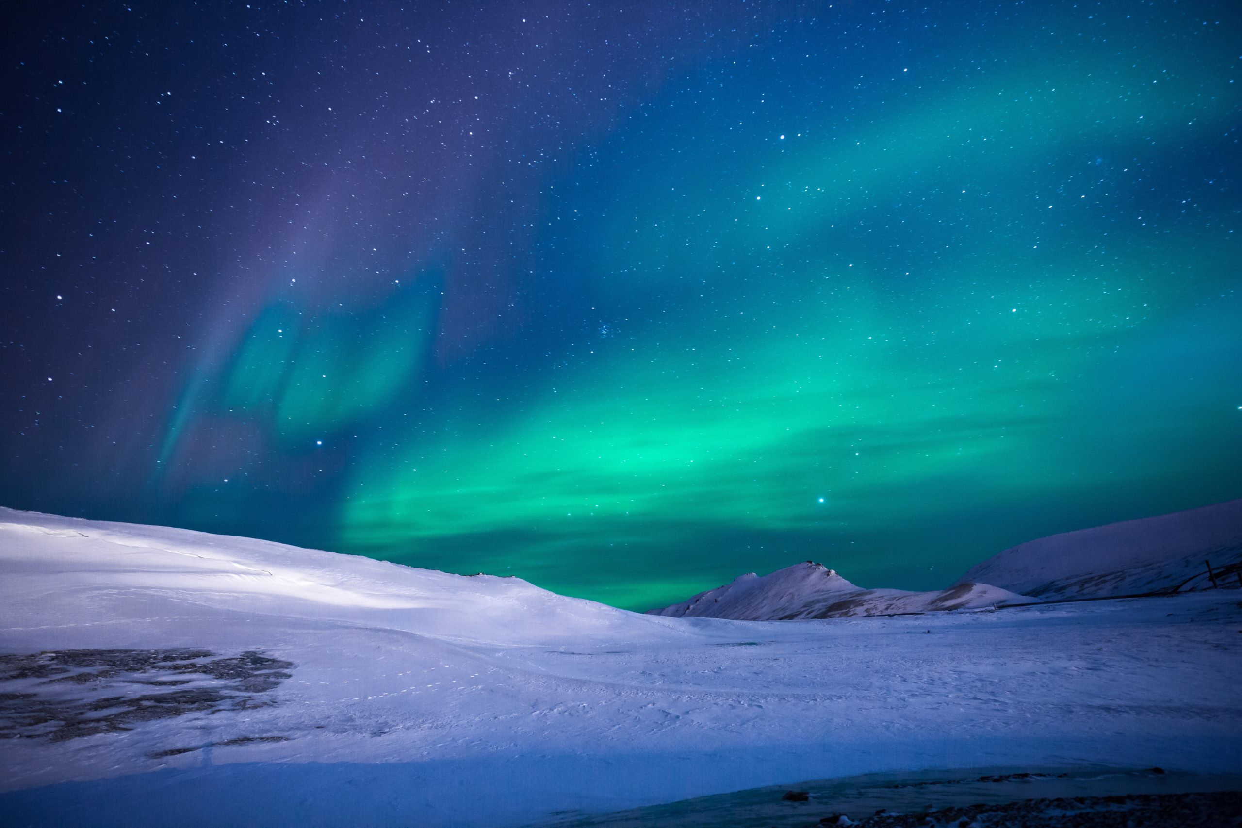 Northern Lights over a snow covered mountian