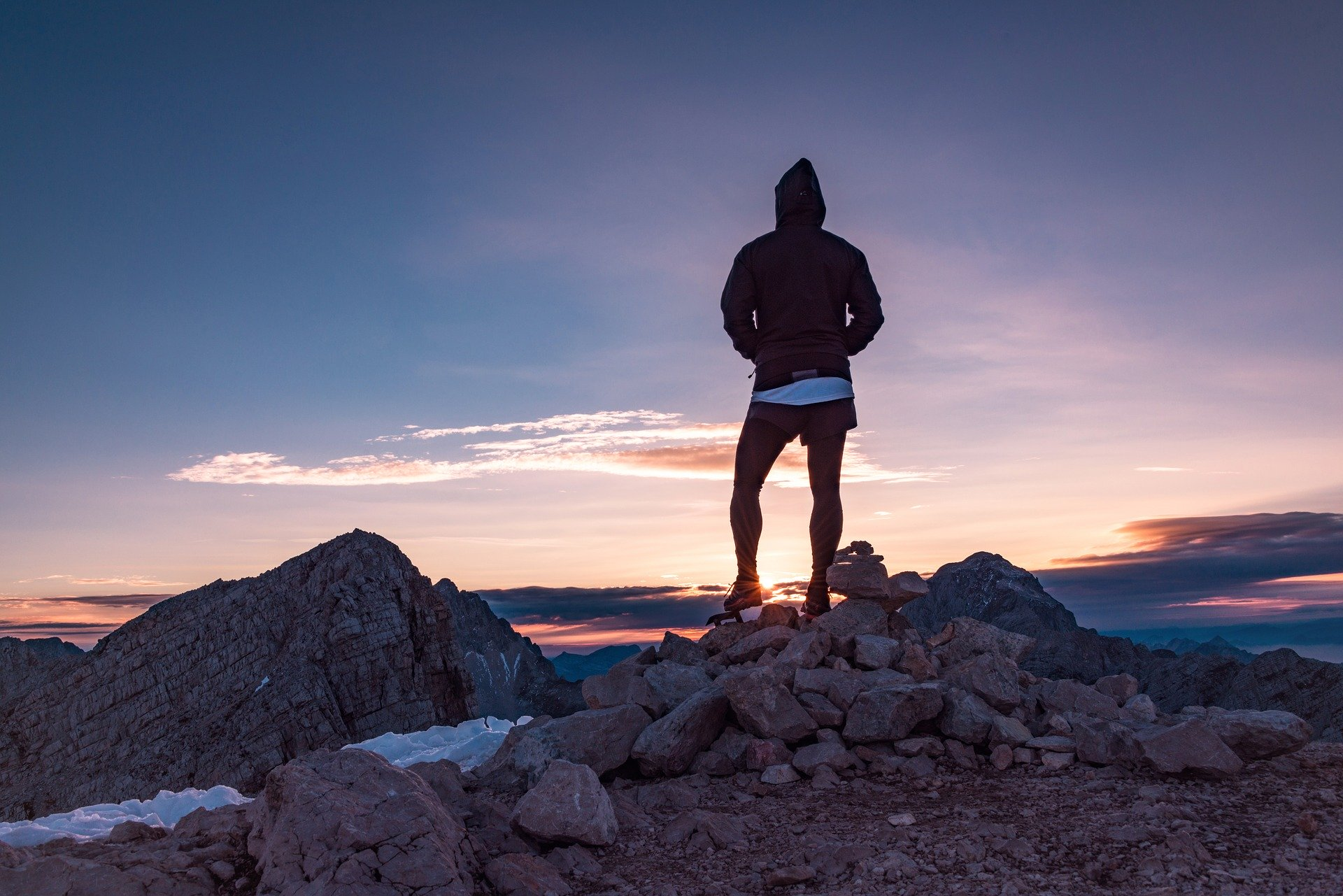 A person at sunrise on a mountian top