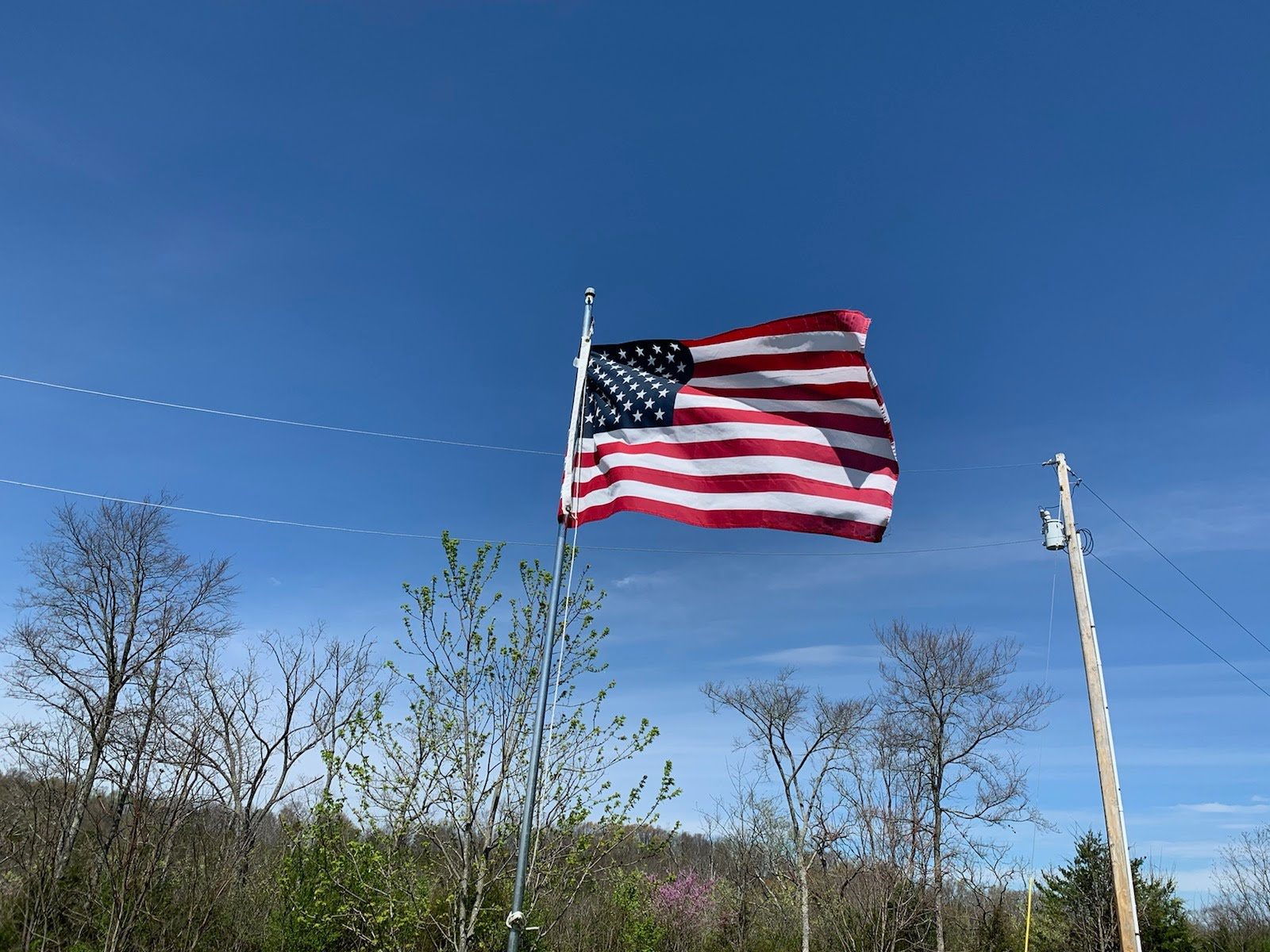 American flag flying in the blue sky